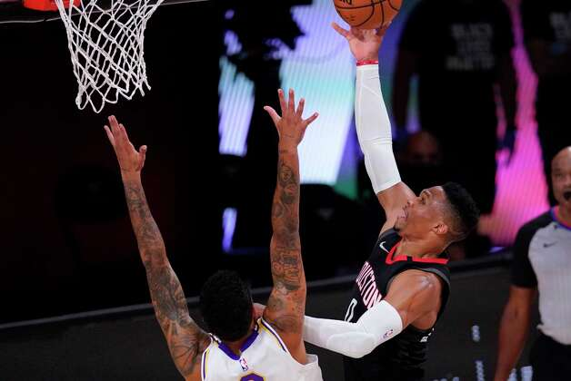 Houston Rockets' Russell Westbrook drives to the basket over Los Angeles Lakers' Kyle Kuzma, left, during the first half of an NBA conference semifinal playoff basketball game Tuesday, Sept. 8, 2020, in Lake Buena Vista, Fla. (AP Photo/Mark J. Terrill) Photo: Mark J. Terrill, Associated Press / Copyright 2020 The Associated Press. All rights reserved.