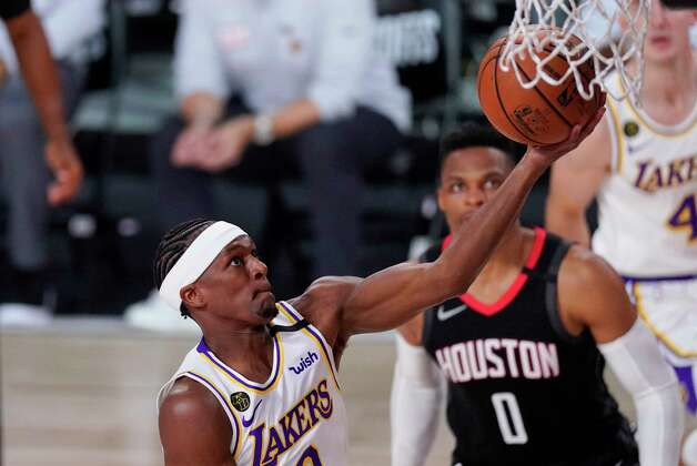 Los Angeles Lakers' Rajon Rondo drives to the basket ahead of Houston Rockets' Russell Westbrook (0) during the first half of an NBA conference semifinal playoff basketball game Tuesday, Sept. 8, 2020, in Lake Buena Vista, Fla. (AP Photo/Mark J. Terrill) Photo: Mark J. Terrill, Associated Press / Copyright 2020 The Associated Press. All rights reserved.