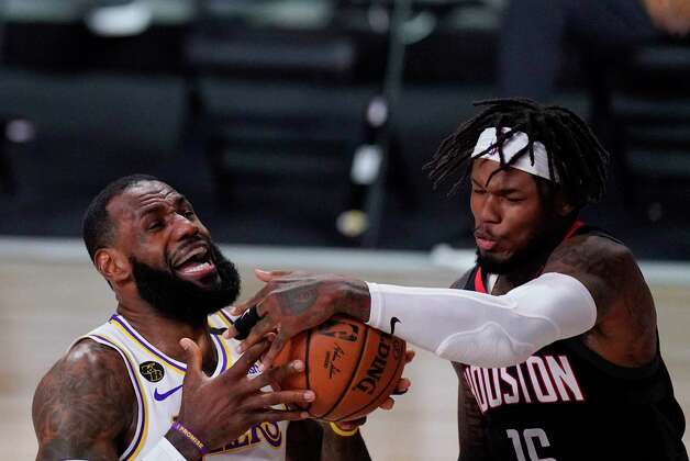 Los Angeles Lakers' LeBron James is fouled by Houston Rockets' Ben McLemore, right, during the first half of an NBA conference semifinal playoff basketball game Tuesday, Sept. 8, 2020, in Lake Buena Vista, Fla. (AP Photo/Mark J. Terrill) Photo: Mark J. Terrill, Associated Press / Copyright 2020 The Associated Press. All rights reserved.