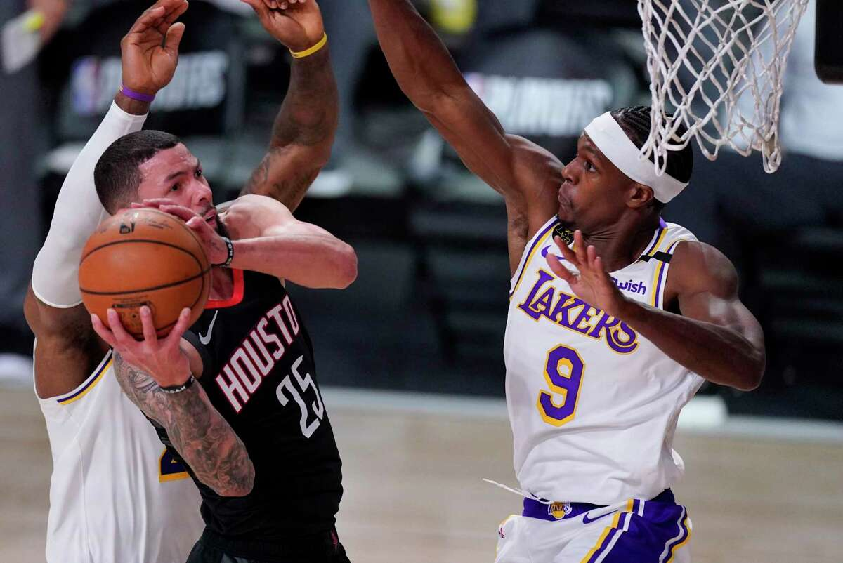 Houston Rockets' Austin Rivers (25) grabs a rebound in front of Los Angeles Lakers' Rajon Rondo (9) during the second half of an NBA conference semifinal playoff basketball game Tuesday, Sept. 8, 2020, in Lake Buena Vista, Fla. (AP Photo/Mark J. Terrill)