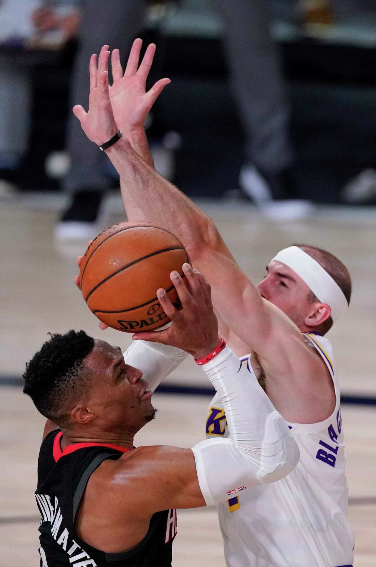 Los Angeles Lakers' Alex Caruso, right, tries to block a shot by Houston Rockets' Russell Westbrook, left, during the second half of an NBA conference semifinal playoff basketball game Tuesday, Sept. 8, 2020, in Lake Buena Vista, Fla. (AP Photo/Mark J. Terrill)