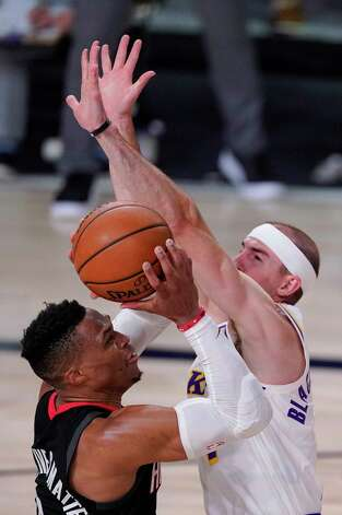Los Angeles Lakers' Alex Caruso, right, tries to block a shot by Houston Rockets' Russell Westbrook, left, during the second half of an NBA conference semifinal playoff basketball game Tuesday, Sept. 8, 2020, in Lake Buena Vista, Fla. (AP Photo/Mark J. Terrill) Photo: Mark J. Terrill, Associated Press / Copyright 2020 The Associated Press. All rights reserved.