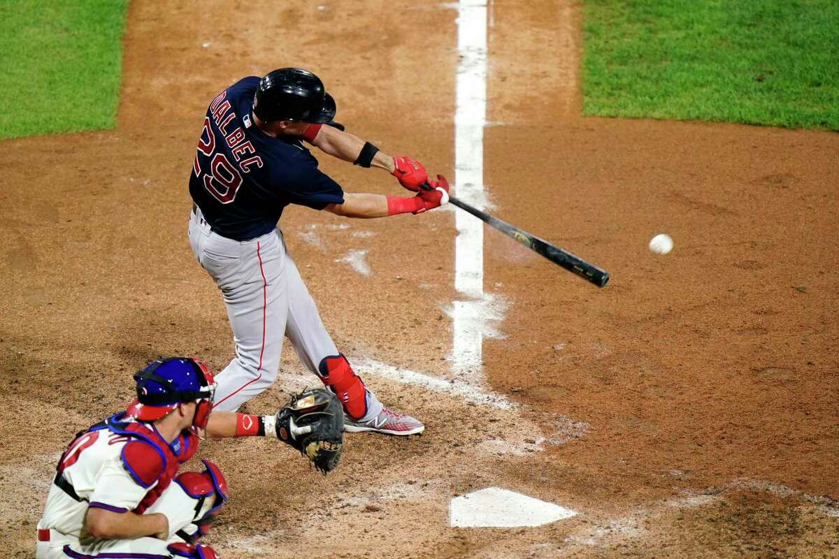 Boston Red Sox's Bobby Dalbec hits a run-scoring single off Philadelphia Phillies pitcher Heath Hembree during the seventh inning of the second baseball game in a doubleheader, Tuesday, Sept. 8, 2020, in Philadelphia. (AP Photo/Matt Slocum)