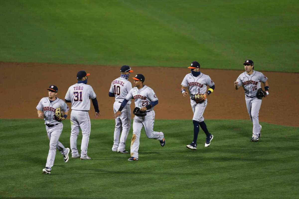 Members of the Houston Astros celebrate after defeating the Oakland Athletics during the second baseball game of a doubleheader in Oakland, Calif., Tuesday, Sept. 8, 2020. (AP Photo/Jed Jacobsohn)