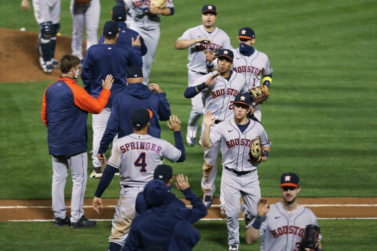 Houston Astros celebrate after defeating the Oakland Athletics during the second baseball game of a doubleheader in Oakland, Calif., Tuesday, Sept. 8, 2020. (AP Photo/Jed Jacobsohn)