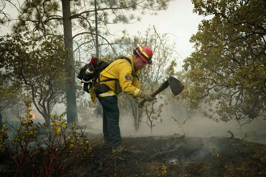 Tim Lesmeister of the Clovis Fire Department puts out hotspots left behind by the Creek Fire Tuesday, Sept. 8, 2020, in Tollhouse, Calif. Photo: Marcio Jose Sanchez, AP / Copyright 2020 The Associated Press. All rights reserved.