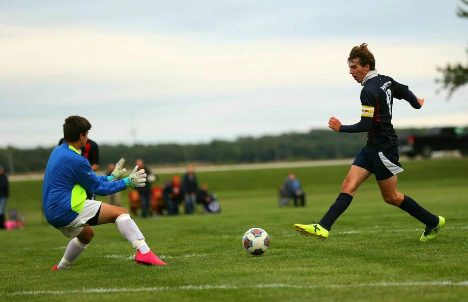 The USA boys varsity soccer team opened their season on Tuesday with a 4-1 home win over Caro. Photo: Quad N Productions/For The Tribune