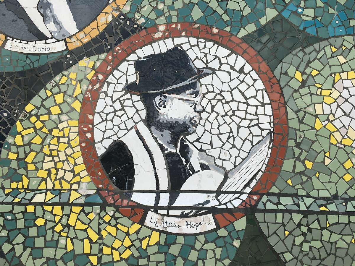 A detail from the Fruits of the Fifth Ward Mural depicting blues legend Sam Lightnin' Hopkins.