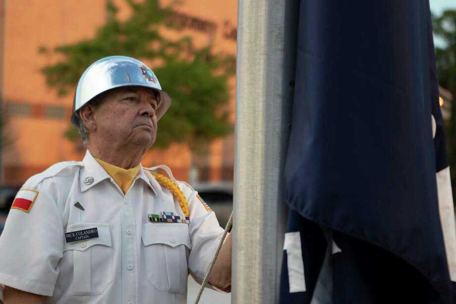 VFW Post 4709 honor guard member Dick Colandro raises The First Flag of the Republic during a flag raising ceremony Tuesday, Oct. 2, 2018 at The Lone Star Memorial and Historical Flag Park in Conroe. Photo: Cody Bahn, Houston Chronicle / Staff Photographer / © 2018 Houston Chronicle
