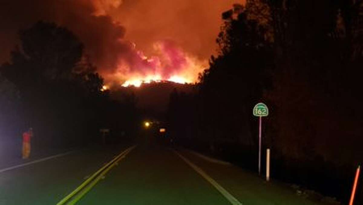 The Butte County Fire Department shared a photo of the view from Oro Quincy Highway (Highway 162) at Forbestown Road. The North Complex Fire has crested the hill across the lake from here.