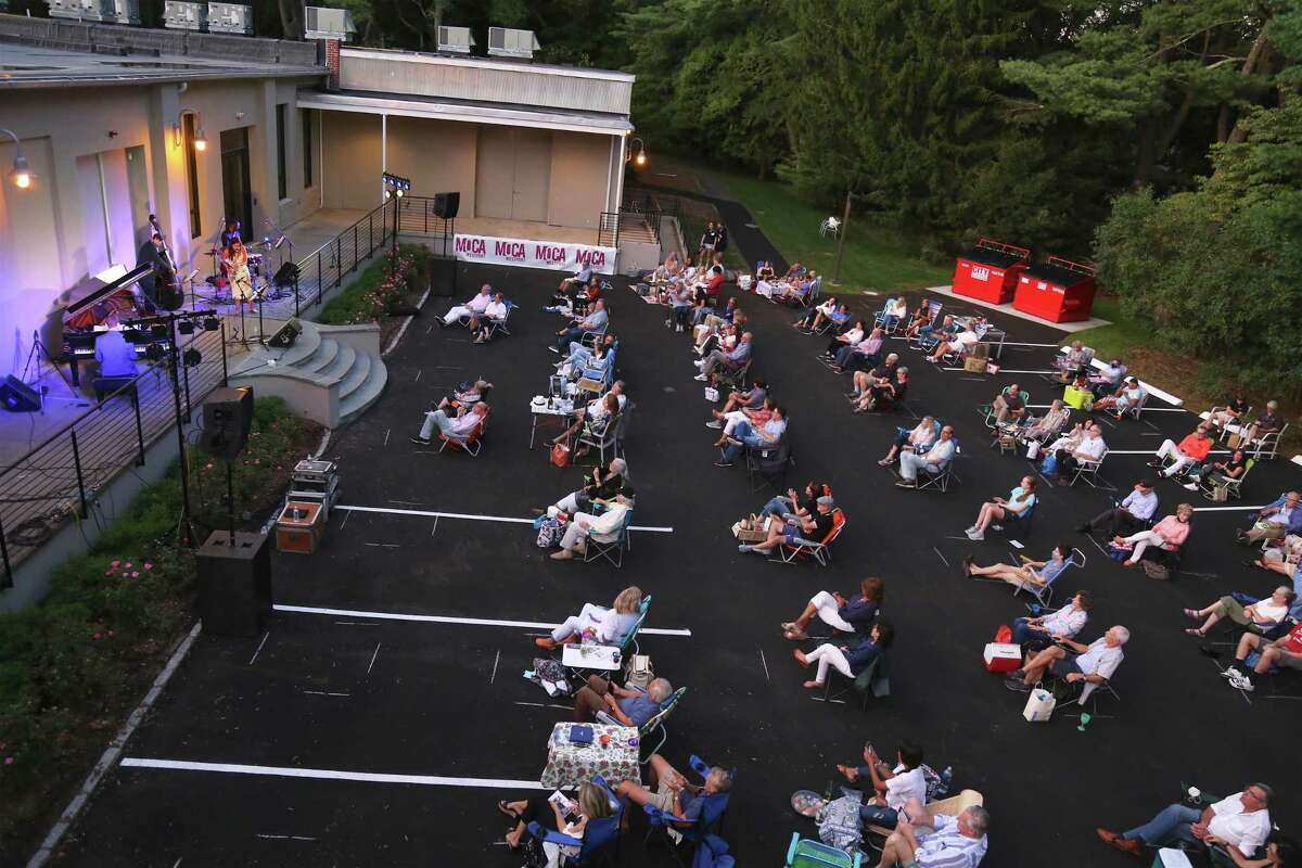 """Safe-distanced seating at the MoCA Westport's Jazz at Lincoln Center event on Friday, Sept. 4, 2020, in Westport, Conn. Platt, who grew up in Westport, said this was an exciting time in the town, which is seeing a rejuvenation of the arts reminiscent of its history. """"I think this is really the beginning of something special,"""" he said. The Fred Hersch Trio will be performing at MoCA on Sept. 26, and legend Wynton Marsalis will play Oct. 2."""