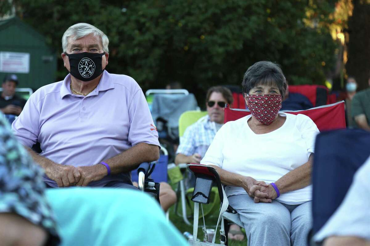 """Joe and Bev Valiante of Westport watch the musicians at the KJD fundraiser concert on Sherman Green on Saturday, Sept. 5, 2020, in Fairfield, Conn. """"We've already had so much support,"""" said Paul Sirbono of Fairfield, a volunteer who oversees the merchandise table each year. He said the Sherman Green location also brought the chance for walk-ins too, as well as annual regular supporters. """"I think it affords us and the town an opportunity to kind of come together,"""" Sirbono said."""