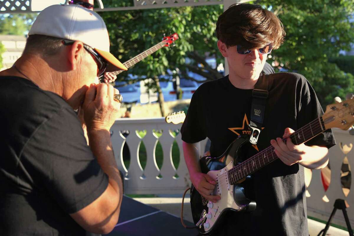 """Band mates Nick Giaquinto, left, and Jack Good of Simple Jim share a jam at the KJD fundraiser concert on Sherman Green on Saturday, Sept. 5, 2020, in Fairfield, Conn. Simple Jim performed a selection of hard-hitting rock songs, which reverberated across downtown and had the crowd smiling. """"We just wanted to keep it safe with being outdoors,"""" said Chris Coppola, drummer for the group."""
