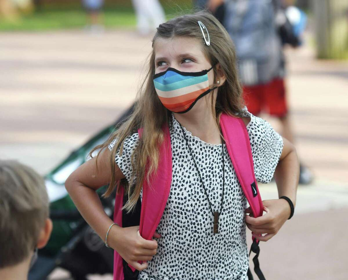 Fourth-grader Victoria Cordero gets ready for the first day of the 2020-2021 school year at Old Greenwich School in Old Greenwich, Conn. Wednesday, Sept. 9, 2020. GREENWICH - Wearing a mask all day is not her preference, but by now, Old Greenwich School fourth-grader Victoria Cordero understands the benefits.