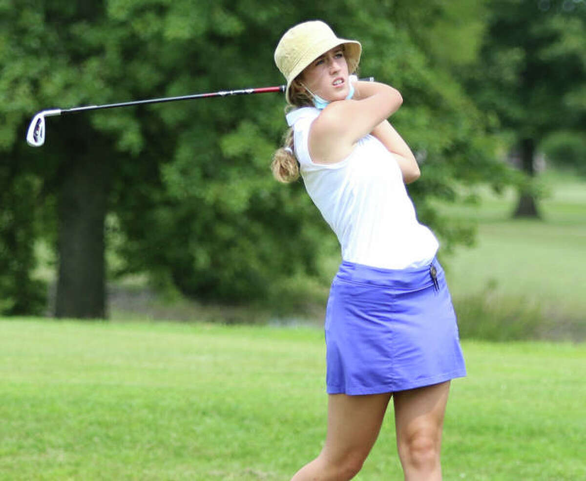 Roxana's Mia McCoy, shown watching her shot Aug. 18 at the Madison County Tourney at The Legacy in Granite City, shot 47 at Litchfield Country Club on Tuesday to lead the Shells to second place in a four-team dual.