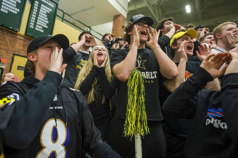 Dow High fans cheer during a March 6, 2020 girls' basketball district final against Midland High. Photo: Daily News File Photo