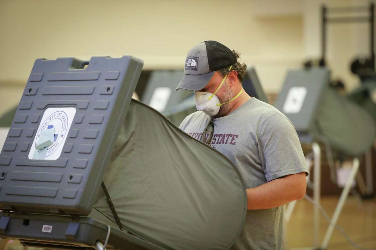 Voters vote at the Metropolitan Multi-Services Center, 1475 West Gray St., Tuesday, July 14, 2020, in Houston.