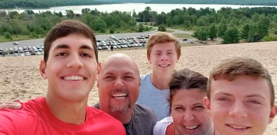 Marv and Amy Jones with their son, Hunter, with exchange students from Brazil and Italy. (Courtesy Photo)