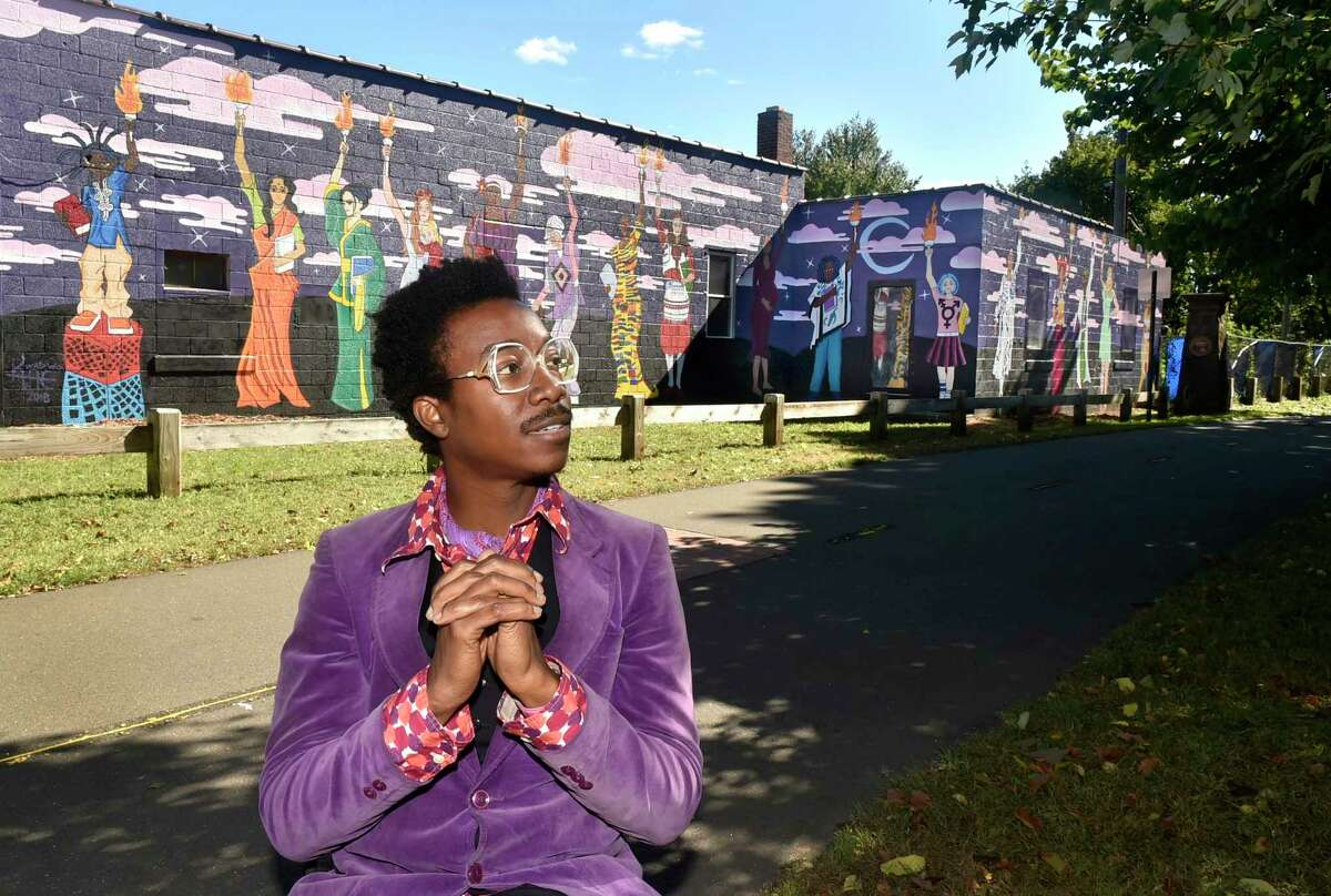 Muralist Kwadwo Adae of Bethany and the Adae Fine Arts Academy in New Haven with his Women's Empowerment Mural on the Farmington Canal Greenway on Goodrich Street near Dixwell Avenue. A Black Lives Matter mural, meanwhile, has been proposed for West Haven, after street versions in New York and Washington, D.C. Eight years ago, we were intrigued by the work of an anonymous muralist who called himself BiP (for Believe in People), who made lovely art on New Haven buildings in 2012-13 before he moved out West. New Haven artist and muralist Kwadwo Adae said BiP