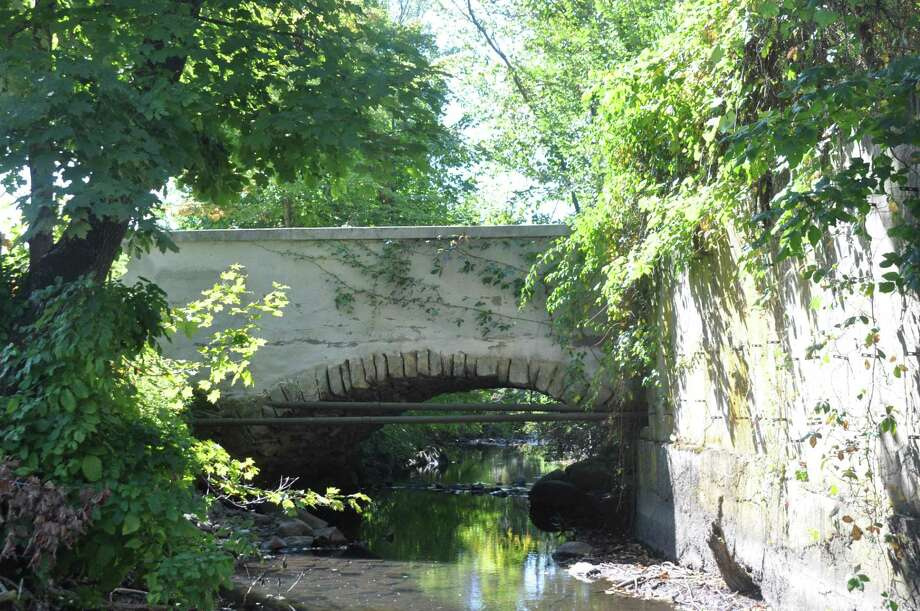 Depot Road Bridge, with its stone archway over the Norwalk River, will remain closed until major repairs can be undertaken. Photo: Macklin Reid / Hearst Connecticut Media