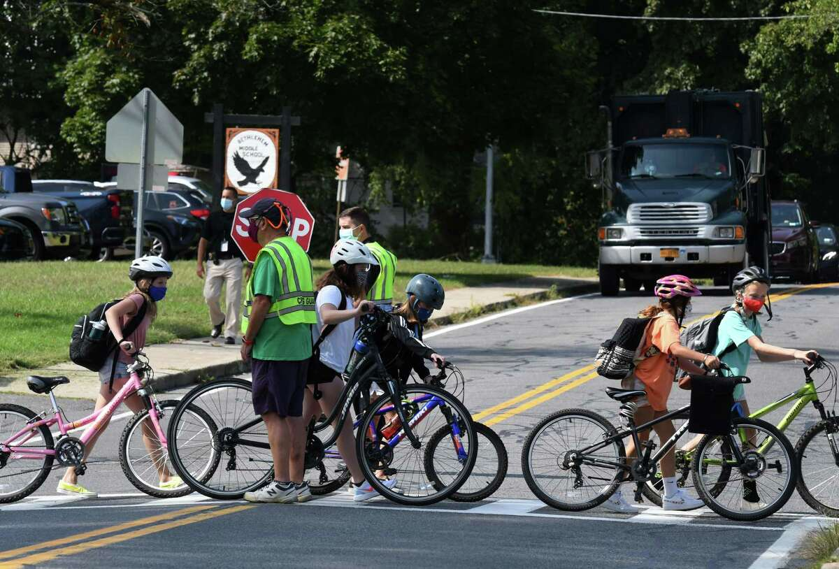 Bethlehem Middle School students return home following a school orientation session on Wednesday, Sept. 9, 2020, on Kenwood Avenue in Delmar, N.Y. Bethlehem Central School District students are facing more remote learning as coronavirus cases continue to be confirmed. (Will Waldron/Times Union)