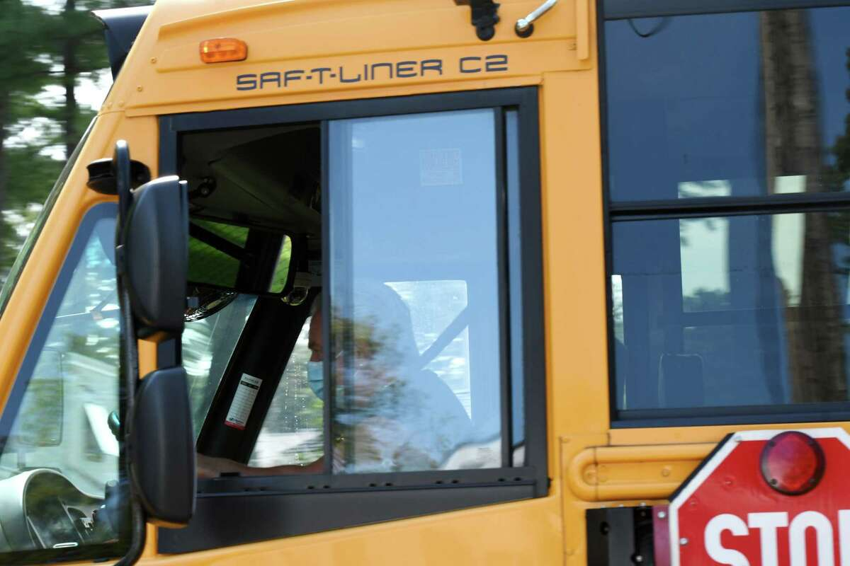 A masked Bethlehem Central School District bus driver transports Bethlehem Middle School students following a school orientation session on Wednesday, Sept. 9, 2020, on Kenwood Avenue in Delmar, N.Y. Bethlehem Central School District students are beginning to return to the classroom under coronavirus safety guidelines. (Will Waldron/Times Union)