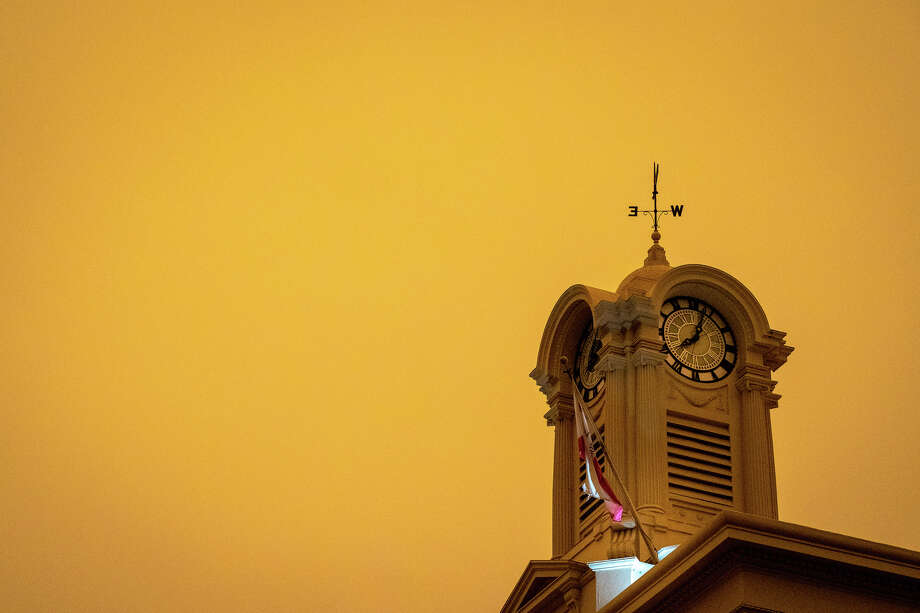 The orange sky above Santa Rosa Courthouse Square around 8:30 in the morning on Sept. 9, 2020. Photo: Michael Dolan