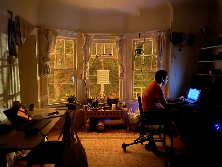 At 8:50 in the morning Alexander Gregor gears up for working from home with very little light on Sept. 9, 2020. Photo: Rebecca Hyde