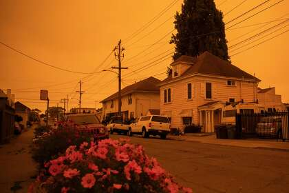 The sky glows a yellow-orange color due to multiple wildfires burning across California and Oregon as the sun rises over San Francisco, Calif. Wednesday, September 9, 2020.