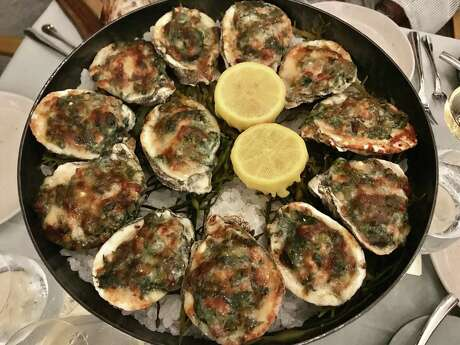 Roasted oysters with watercress and Parmesan at Bludorn