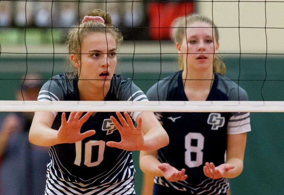 College Park middle blocker Cassidy Copeland (10) awaits a serve beisde right side hitter Mallory Madison (8) during the first set of a District 15-6A high school volleyball match at The Woodlands High School, Tuesday, Sept. 3, 2019, in The Woodlands. Photo: Jason Fochtman, Houston Chronicle / Staff Photographer / Houston Chronicle