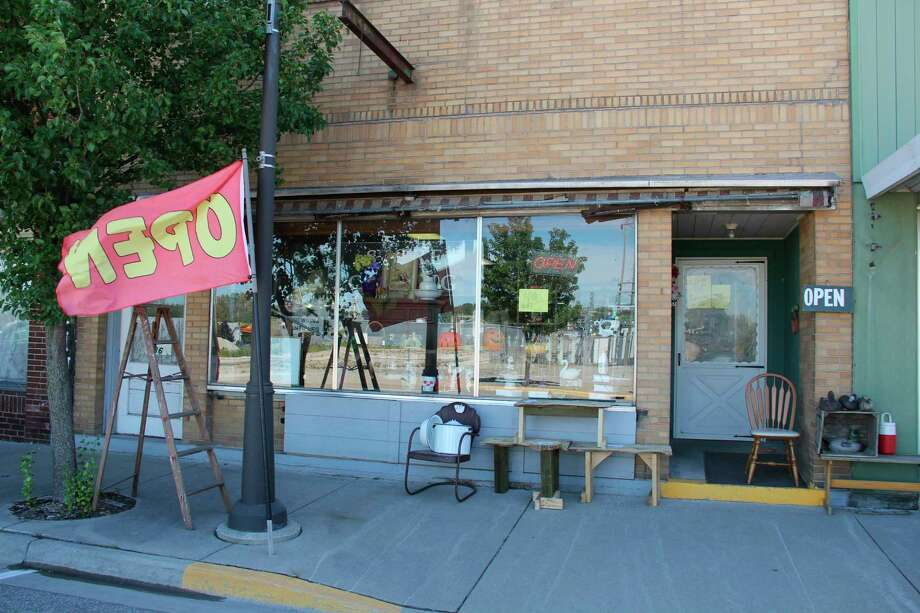 The storefront of Sebewaing Antiques and Coins in Sebewaing. The store will close by the end of the year and is selling its entire stock. (Robert Creenan/Huron Daily Tribune)