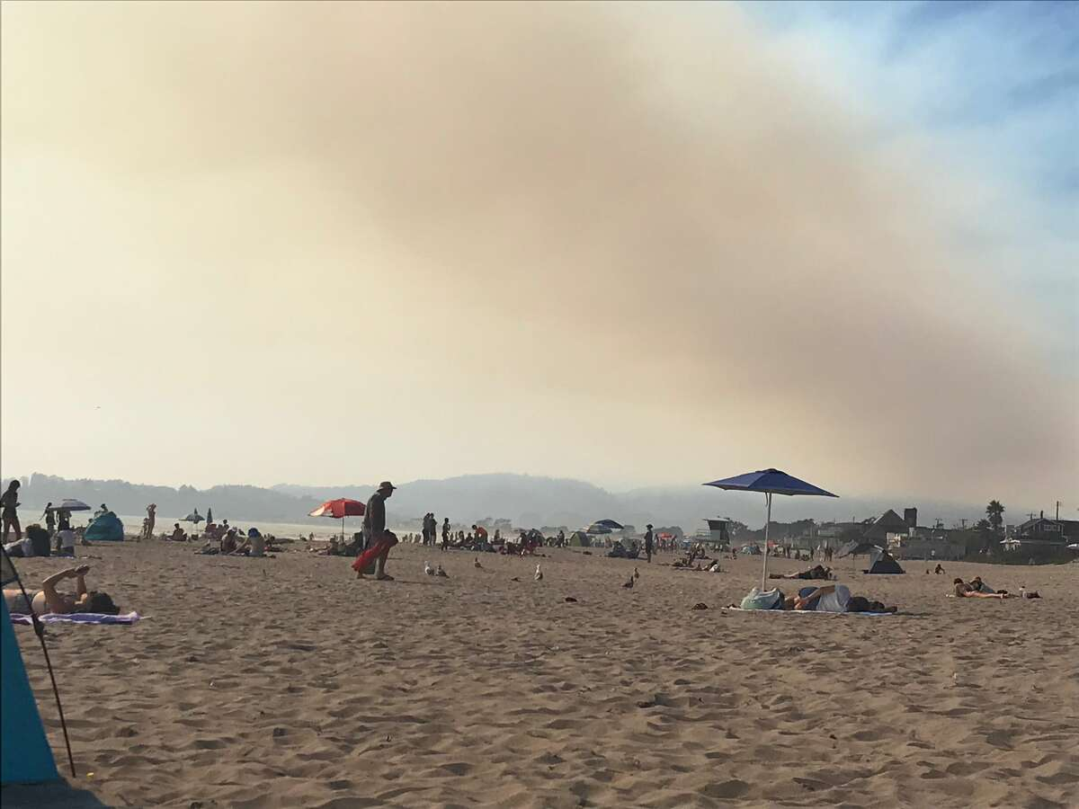 Stinson Beach in August 2020 with the smoke from the Point Reyes Woodward Fire in the distance.
