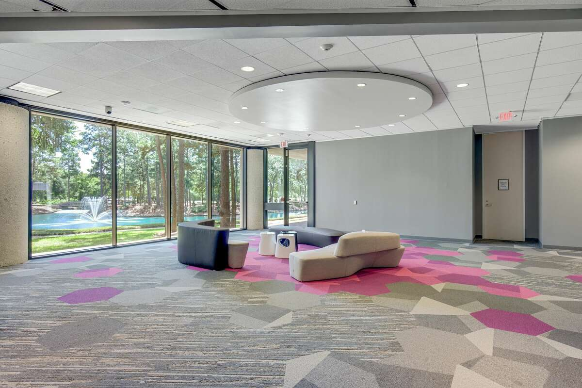 Dart Interests unveiled renovations of its Republic Square multi-tenant office campus at 13501 Katy Freeway. A common space shows pod seating in the building.