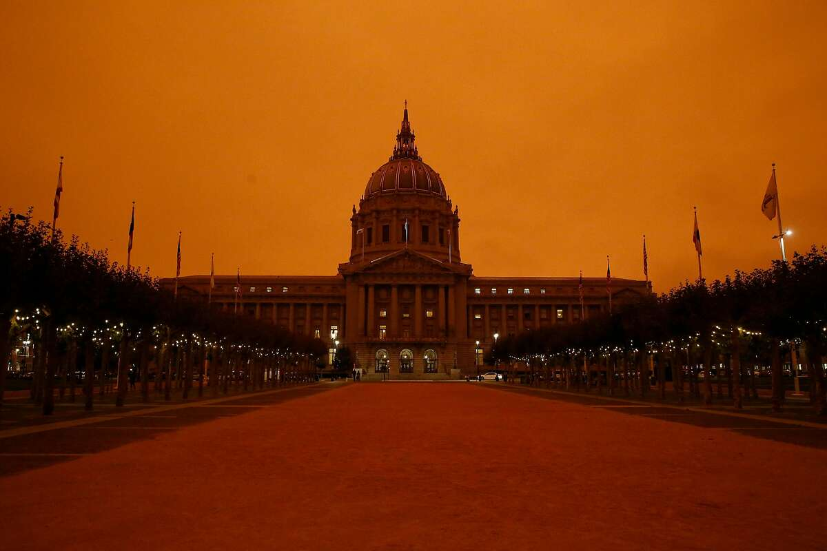 City Hall is seen under a sky glowing orange due to smoke from the wildfires on Wednesday, September 9, 2020 in San Francisco, Calif.