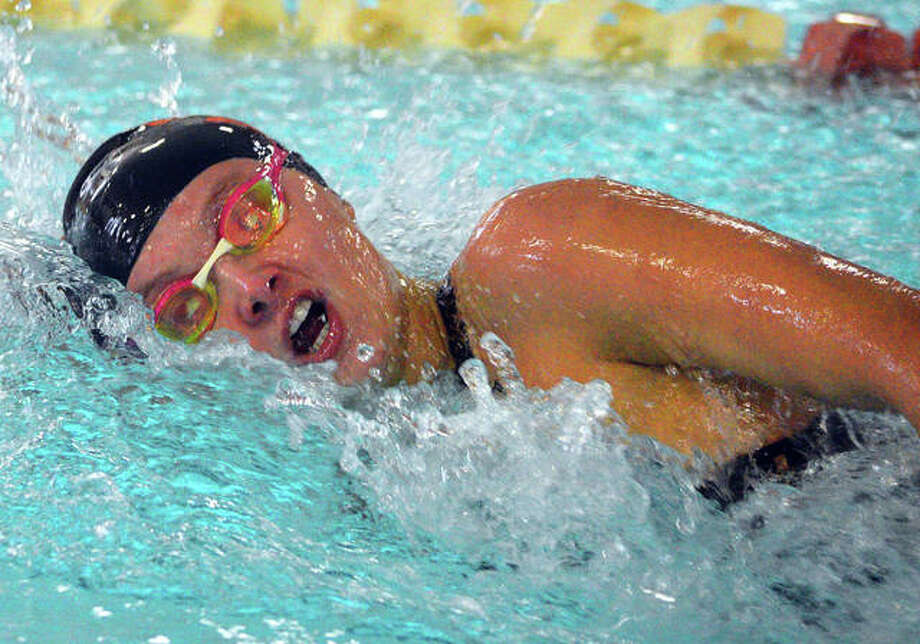 Edwardsville's Autumn Grinter swims in the 100-yard freestyle last year during the Springfield High Sectional at Eisenhower Pool. Photo: Scott Marion/The Intelligencer