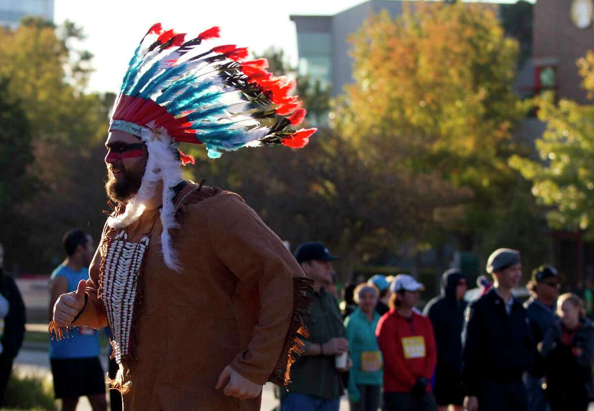 The 2020 YMCA Run Thru The Woods fun run has been canceled. Ricky Henry, dressed as a Native American, runs with family and friends as he takes part in the annual YMCA Run Thru the Woods with family and friends on Thanksgiving, Thursday, Nov. 23, 2017, in The Woodlands.