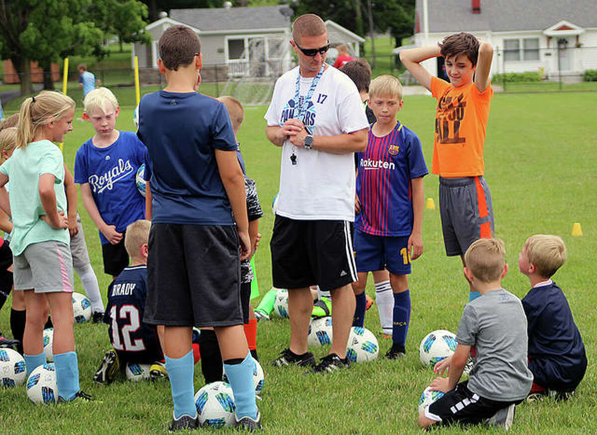 Jersey High School boys soccer coach Scott Burney, center, gives instructions to a group of summer soccer campers at the 2019 Panthers Soccer Camp at JCHS.
