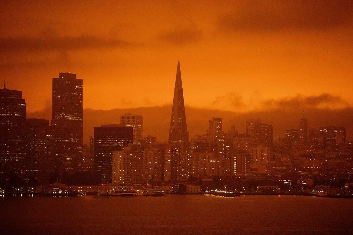 Dark orange skies hang over the San Francisco skyline seen from Treasure Island in San Francisco, Calif. Wednesday, September 9, 2020 due to multiple wildfires burning across California and Oregon.