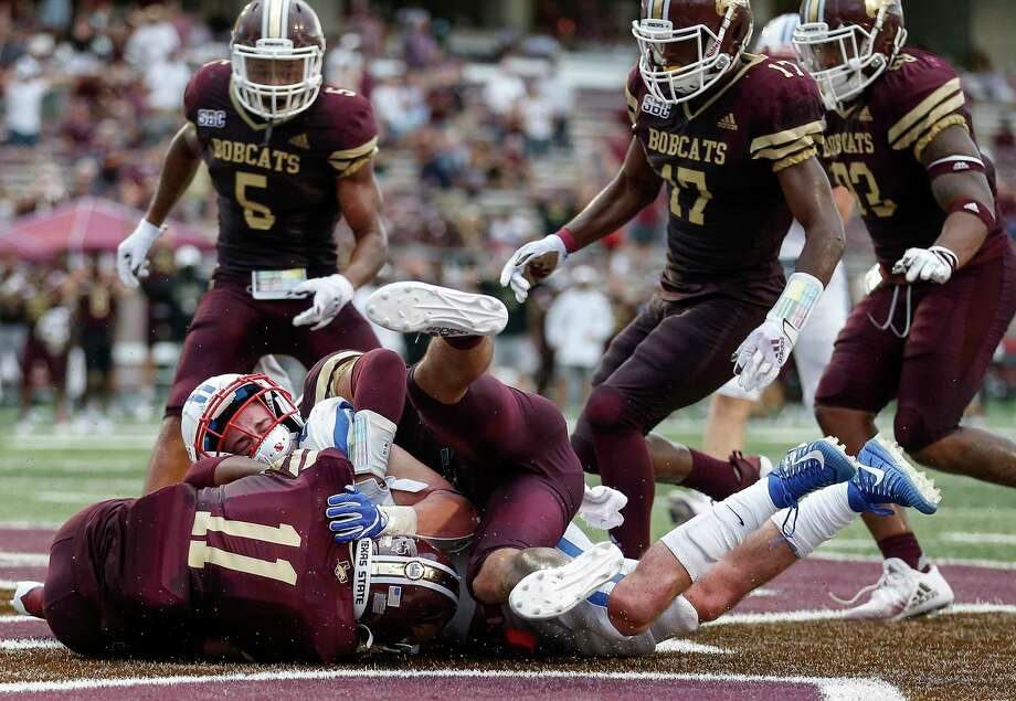 New Caney alum Zion Childress (11) of the Texas State Bobcats recovers a fumble in the end zone by TJ McDaniel (25) of the Southern Methodist Mustangs in the second half at Bobcat Stadium Saturday in San Marcos. Photo: Tim Warner, Stringer / Getty Images / 2020 Getty Images
