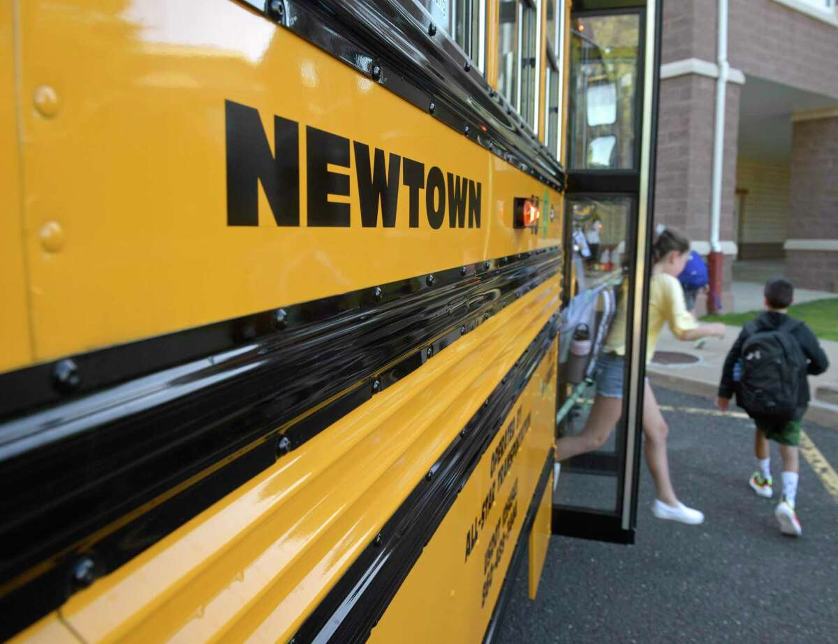 Students get off the school bus for their first day of school at Reed Intermediate School. Monday, August 26, 2019, Newtown, Conn.