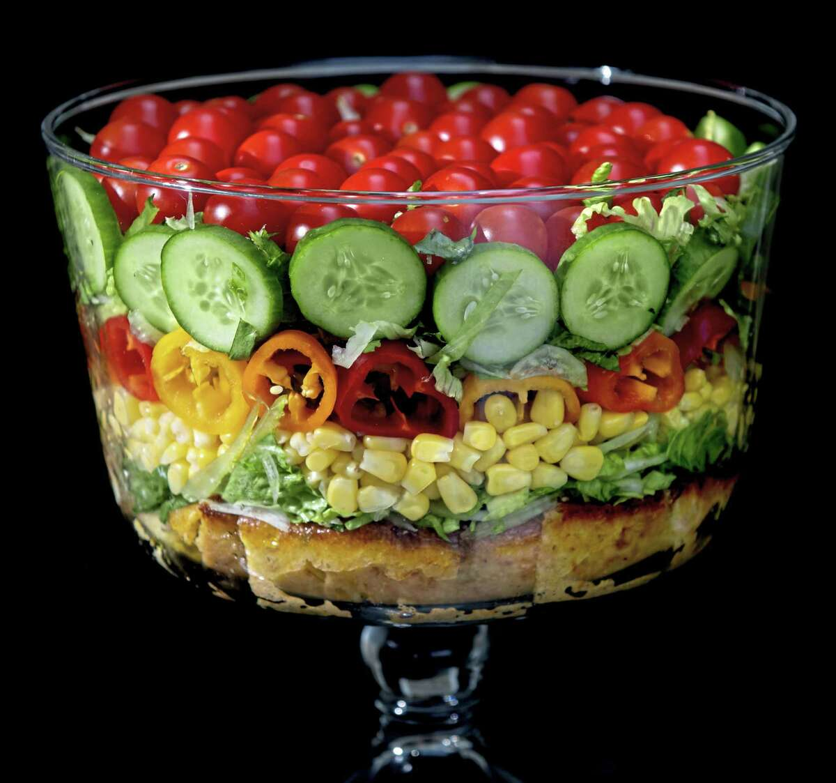 Built on a layer of savory cornbread, the summer trifle salad is made with shredded romaine lettuce, sweet corn, mini peppers, cucumbers and cherry tomatoes. Shot in Oakmont, Pennsylvania on Friday, August 21, 2020. (Steve Mellon/Pittsburgh Post-Gazette/TNS)