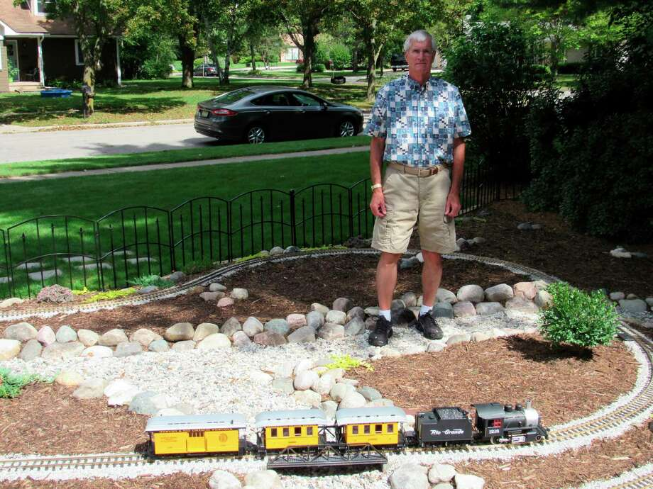 Gary Scott, of Midland, stands in the middle of his garden railroad, which he began working on earlierthis summer. Scott currently has only one train, but has the capacity to add onto the garden railroad. (Victoria Ritter/vritter@mdn.net)