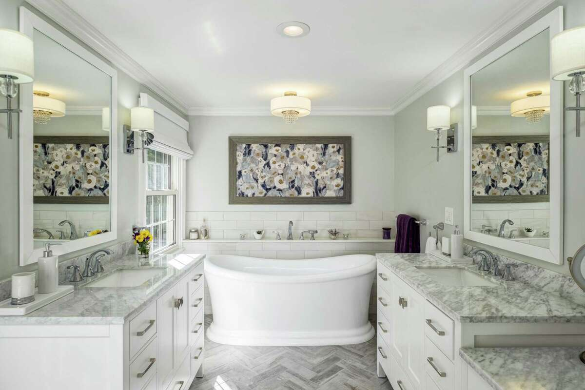 The master bath received an $85,000-plus update including a soaking tub, glass shower, double vanities with quartzite counters and flooring arranged in a herringbone pattern. Even closer to this house are Burr Elementary School and the Connecticut Audubon Center, both on Burr Street, and the Audubon Center's Roy and Margot Larsen Wildlife Sanctuary. All are only about a five-minute walk from the house. The Audubon trails allow for hiking, snowshoeing, and cross country skiing. There are seven miles of trails including the Chiboucas wheelchair-accessible trail. This 4,237-square-foot house and its 2.23-acre level property are