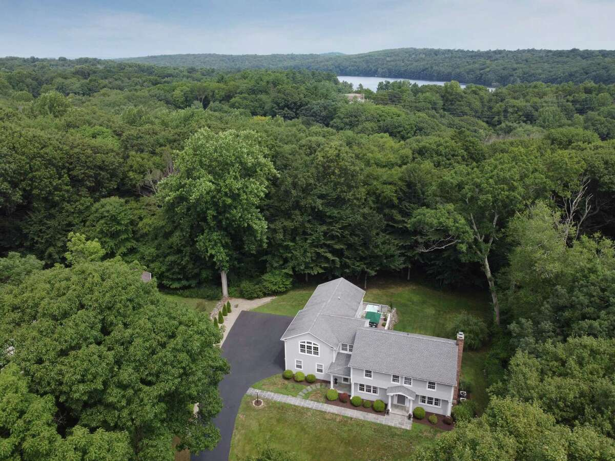 This house sits in a very private setting in Greenfield Hill yet not far from the Merritt Parkway, Black Rock Turnpike shopping and dining, Burr Elementary School, and the Connecticut Audubon Center.