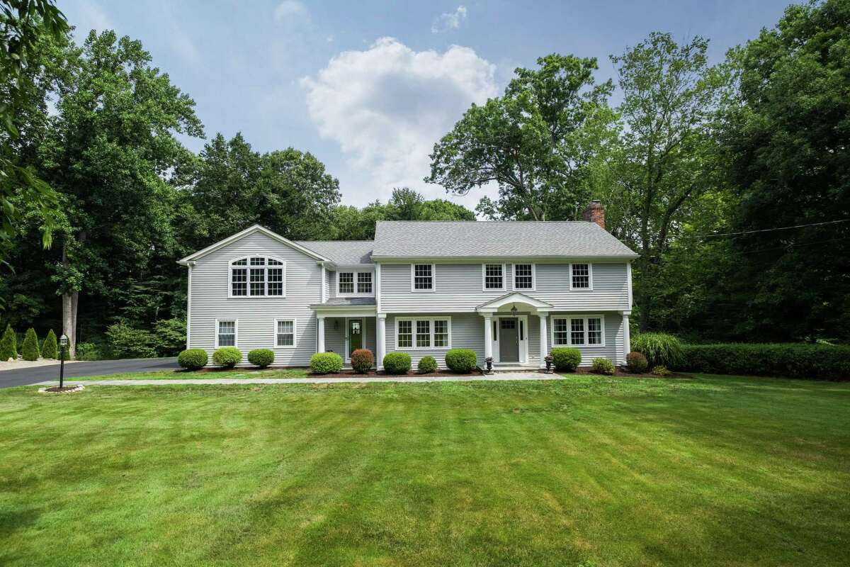 The gray colonial house at 354 Towne House Road sits on a 2.23-acre level parcel in Greenfield Hill. It has undergone further updates since then. Just this year the exterior of the house was painted in the Benjamin Moore color Grey Huskie. And from 2018 through this year the interior rooms were painted with on-trend neutrals and an overall pleasing color palette. A new driveway was installed in 2015 and four years later a row of arborvitaes were planted along a portion of the driveway near the attached under-house two-car garage, above which is a bonus room, currently used as a family room. This versatile space could serve as a recreation, game or play room. That same year an existing bedroom was converted into a dressing room for the master suite. The expansive raised deck was added using composite materials, minimizing maintenance.