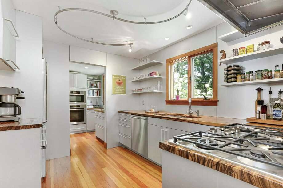 In the custom Poggenpohl kitchen features include zebrawood counters and Miele appliances. Photo: Al Filippone Associates And William Raveis Real Estate / Contributed