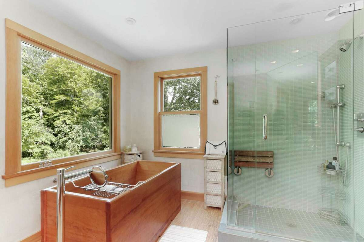 The sophisticated master bath has a Japanese soaking tub, bamboo flooring, glass shower and large picture window looking over the tranquil yard. According to the listing agent, this 2,028-square-foot home