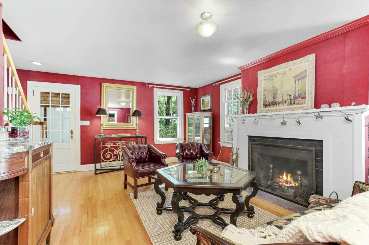 The formal living room has a wood-burning fireplace. According to the listing agent, this 2,028-square-foot home