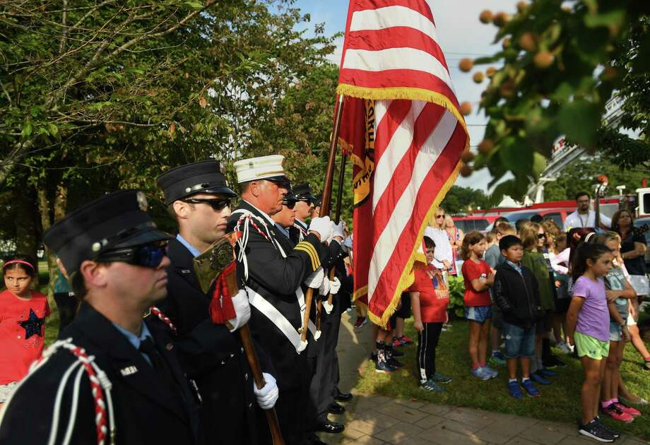 The Milford Fire Department Color Guard stands at attention during the annual Milford Remembers 9/11 ceremony at the Live Oaks School Memorial Garden in Milford, Conn. on Wednesday, September 11, 2019. Photo: Brian Pounds / Hearst Connecticut Media / Connecticut Post